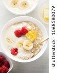 porridge with banana yoghurt ... | Shutterstock . vector #1068580079