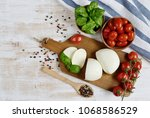 mozzarella cheese with red... | Shutterstock . vector #1068586529