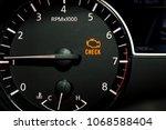 check engine light illuminated... | Shutterstock . vector #1068588404