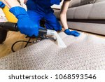 cleaning service. man janitor... | Shutterstock . vector #1068593546