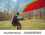 paragliding take off | Shutterstock . vector #1068600083