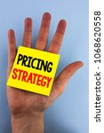 Small photo of Conceptual hand writing showing Pricing Strategy. Business photo showcasing Marketing sales strategies profit promotion campaign written Sticky Note Paper the plain background Hand