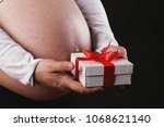 young preganant woman holding... | Shutterstock . vector #1068621140
