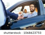 young and handsome businessman...   Shutterstock . vector #1068623753