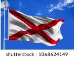 Alabama flag USA flag  Silk waving flag of Alabama US state on blue sky with white clouds background 3d illustration.