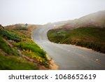 Winding Road Through The Fog O...