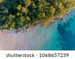 beach aerial sunrise | Shutterstock . vector #1068657239