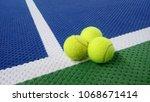 tennis balls on an indoor... | Shutterstock . vector #1068671414
