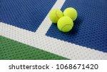 tennis balls on an indoor... | Shutterstock . vector #1068671420