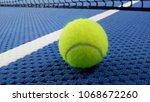 tennis balls on an indoor... | Shutterstock . vector #1068672260