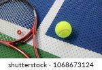 tennis racket with a tennis... | Shutterstock . vector #1068673124