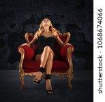 sensual woman on a red velvet... | Shutterstock . vector #1068674066