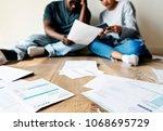 couple managing the debt | Shutterstock . vector #1068695729