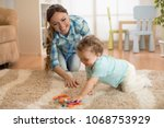 loving mom and baby toddler... | Shutterstock . vector #1068753929