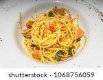 home made style spaghetti on... | Shutterstock . vector #1068756059