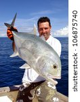 Happy  Fisherman Holding A...