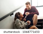 cheerful young couple is talking | Shutterstock . vector #1068771653