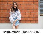portrait of thai jeans skirt... | Shutterstock . vector #1068778889