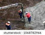 top view of builders in red... | Shutterstock . vector #1068782966