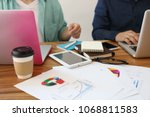 two man working with laptop on... | Shutterstock . vector #1068811583