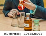 students experimenting and... | Shutterstock . vector #1068828038