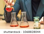 students experimenting and... | Shutterstock . vector #1068828044