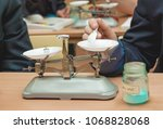 students experimenting and... | Shutterstock . vector #1068828068