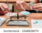 students experimenting and... | Shutterstock . vector #1068828074