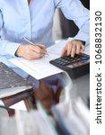 female bookkeeper or financial... | Shutterstock . vector #1068832130