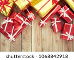 present boxes on wood... | Shutterstock . vector #1068842918