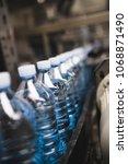 bottling plant   water bottling ...   Shutterstock . vector #1068871490