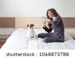 beautiful young woman taking a... | Shutterstock . vector #1068873788
