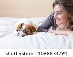 beautiful young woman lying on... | Shutterstock . vector #1068873794