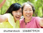 happy senior mother and... | Shutterstock . vector #1068875924