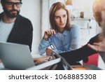 three coworkers at working... | Shutterstock . vector #1068885308
