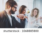 group of young entrepreneurs... | Shutterstock . vector #1068885800