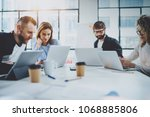 brainstorming process at office.... | Shutterstock . vector #1068885806