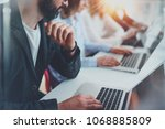 closeup view of young coworkers ... | Shutterstock . vector #1068885809