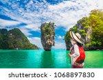 traveler asia woman relaxing on ... | Shutterstock . vector #1068897830