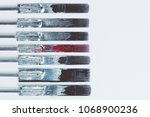 colorful tattoo needles... | Shutterstock . vector #1068900236