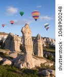 Small photo of Colorful hot air balloons flying over valley in Cappadocia, Anatolia, Turkey