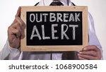 outbreak alert text written on... | Shutterstock . vector #1068900584