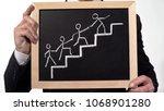 man leading team image drawn on ... | Shutterstock . vector #1068901280