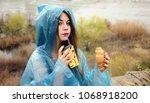 happy girl in raincoat with cup ... | Shutterstock . vector #1068918200