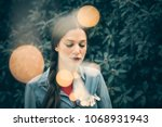 moody and emotional portrait of ... | Shutterstock . vector #1068931943