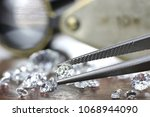 brilliant cut diamond held by... | Shutterstock . vector #1068944090