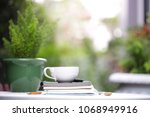 white cup and notebooks with... | Shutterstock . vector #1068949916