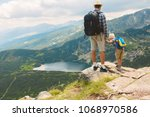 father and son traveling in... | Shutterstock . vector #1068970586