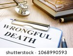 Small photo of Wrongful death form and stethoscope on a table.