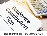 Small photo of Documents with title Employee Contribution Plan on a desk.